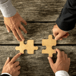 Fusion entreprise - Acquisition entreprise société - Partenariat -Une